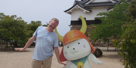 "Hikone-jo Castle, Per Christian, and ""Hikonyan"" (a mascot of the castle's 400th anniversary)."